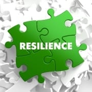jigsaw puzzle pieces with the word resilience written