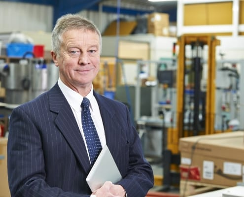 Man standing in warehouse of products