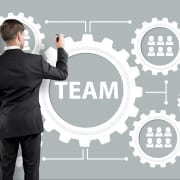 man drawing cogs to demonstrate team