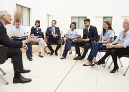 group of practitioners in staff meeting